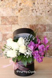 The special design prepared with purple orchids and white roses in the round box will make your love very, very happy. Approximate Product Size: 25 cm
