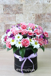 Arrangement of the most beautiful and colorful flowers of the season in a round box will make you smile. Approximate Product Size: 30 cm