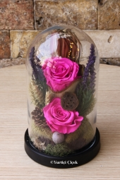 Three white non-fading roses in a pear glass vase are candidates to be the most innocent and lasting gift of your love.
