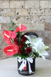 A high quality boutique arrangement made from orchids, lilies and roses, along with chocolate in a special drawer box.