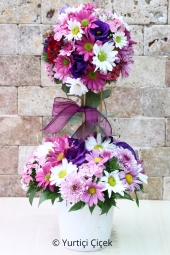 Designed in soft colors on special branches loved ones with a different flower arrangement send the ball.