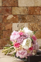 Bouquet of pink and purple roses prepared with exotic greens will be an unforgettable gift for your loved ones.