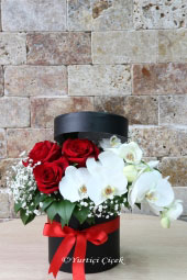 Send it to your loved ones with the arrangement of red roses and white orchids and the most beautiful flowers in the box. Approximate Product Size: 25 cm