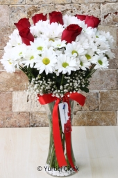 You can send your loved ones a bouquet of roses in a vase with daisies and a smile on their face in open.