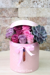You can make an unforgettable surprise to your loved ones with the boutique arrangement prepared with sukulent and colored roses in the pink box.
