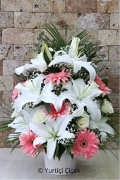 White Lilies, Pink Gerbera and White Roses  Elegant lilies and roses flower arrangement come to your mind when you say.