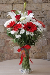 White Lilies, Red Roses, Gerbera and Wildflowers   Everything you tell him a bouquet of flowers. Love, or want to express your feeling sorry that you are going to tell your loved ones with a bouquet.